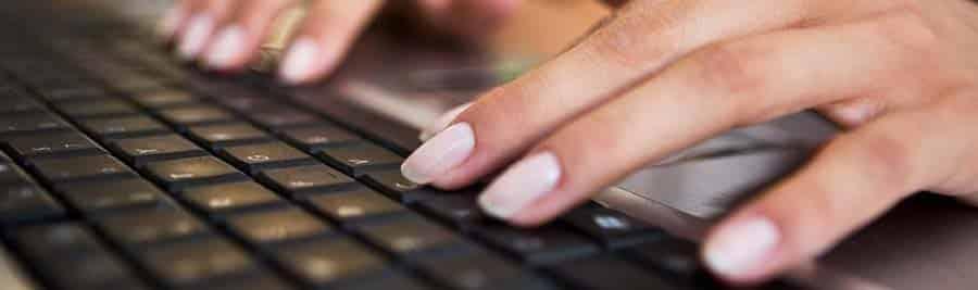 A ghostwriter's fingers flying across the keyboard!